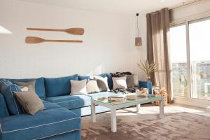 A seating area at Enjoybcn Marina Apartment