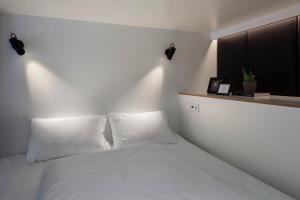 מיטה או מיטות בחדר ב-Zoku Amsterdam