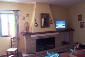 A television and/or entertainment centre at Casa Rural Victor