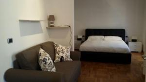 A bed or beds in a room at Duomo Lux