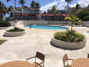 A view of the pool at Dorado Beach 2 Bedroom Oceanfront or nearby