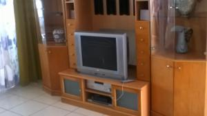 A television and/or entertainment center at Dorado Beach 2 Bedroom Oceanfront
