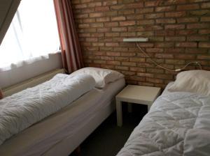 Een bed of bedden in een kamer bij De Wadden