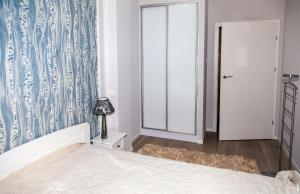 A bed or beds in a room at Baltic View Apartment