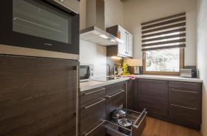Küche/Küchenzeile in der Unterkunft Resort Tirol am Wildenbach