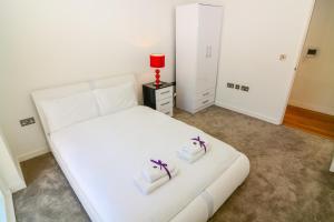 Apartment Wharf - Cambridge Av 객실 침대