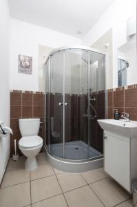 Łazienka w obiekcie Gim Apartments