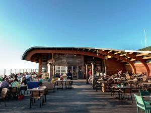 A restaurant or other place to eat at Holiday home @ Sea Lodges Bloemendaal 5
