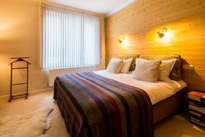 En eller flere senge i et værelse på Aplace Antwerp City Flats & Suites