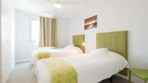 Cama o camas de una habitación en El Yate