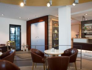 The lounge or bar area at Logis First Class Business Suites