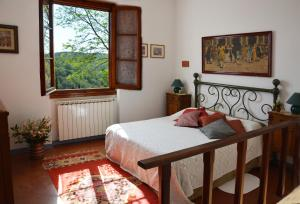 A bed or beds in a room at Poggio Borgoni