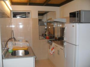 Una cocina o zona de cocina en Katrina XVII