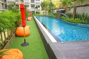 The swimming pool at or near Water Park by Pattaya Sunny Rentals