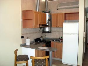 Una cocina o kitchenette en Suites & Room
