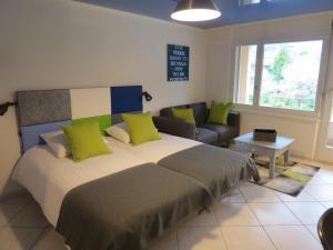 Ein Bett oder Betten in einem Zimmer der Unterkunft Saillon Evasion Sarl