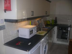 A kitchen or kitchenette at Gweebarra Apartments