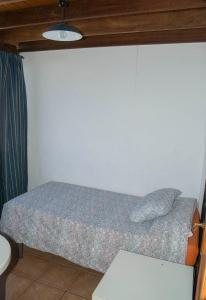 A bed or beds in a room at Casa Chanin