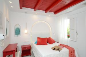 A bed or beds in a room at Naxos Evilion Luxury Apartments & Suites