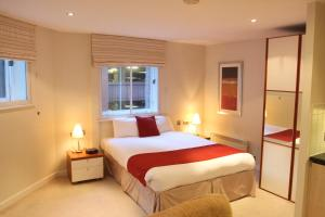 A bed or beds in a room at Atrium Serviced Apartments