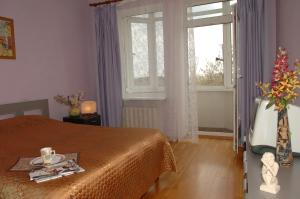 A bed or beds in a room at Apartment on Naberezhnaya 22