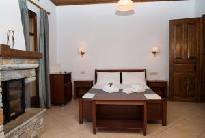 A bed or beds in a room at Guesthouse Enastron