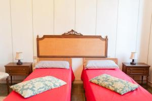A bed or beds in a room at Park Apartment