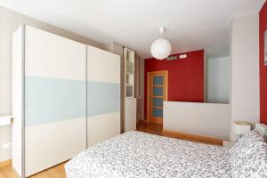 A bed or beds in a room at Ayla Ayuntamiento