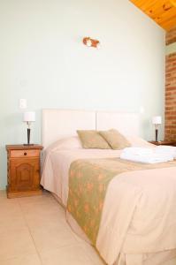 Una cama o camas en una habitación de Complejo 21 de Enero - Luz y Fuerza
