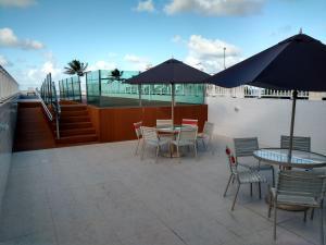 A balcony or terrace at Flat na Beira Mar do Cabo Branco