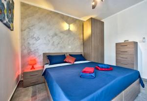 A bed or beds in a room at Central Suites