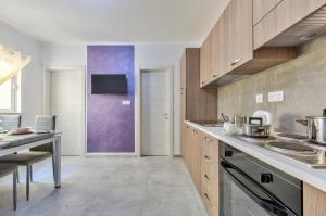 A kitchen or kitchenette at Central Suites