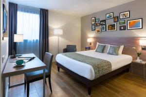 A bed or beds in a room at Citadines Wilson Toulouse