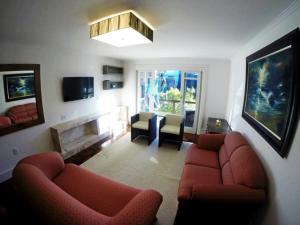 Uma área de estar em Residencial Borges