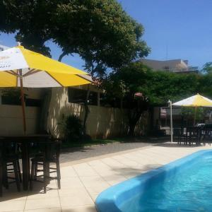 The swimming pool at or near Residencial Rota do Sol