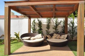 A seating area at Riviera Park - Flat Residencial