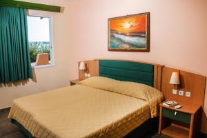 Letto o letti in una camera di Limanaki Apartments