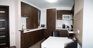 A kitchen or kitchenette at 2 Doors Apartments - City Center