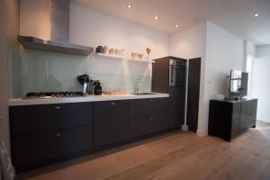 Kitchen o kitchenette sa Vakantiehuis Zandvoort