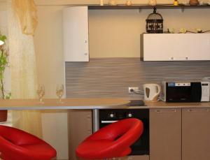 Кухня или мини-кухня в Apartments Azina