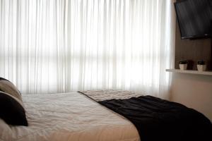 Cama o camas de una habitación en Cochrane Departamentos Amoblados