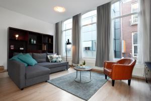 Atpūtas zona naktsmītnē Stayci Serviced Apartments Grand Place
