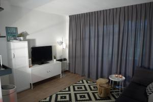A television and/or entertainment center at Amelander Kaap 101