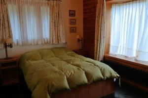 Una cama o camas en una habitación de Apartamento Particular Los Notros