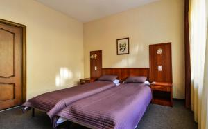 A bed or beds in a room at Apartment Pariser Platz
