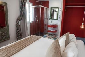 Cama o camas de una habitación en Alhanía Vejer