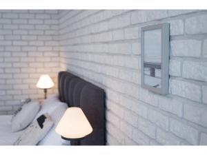 Łóżko lub łóżka w pokoju w obiekcie Well Well Aparthotel