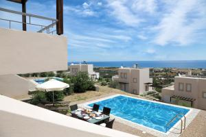 A view of the pool at Athoniki Villas or nearby