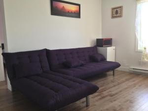 A seating area at Circumplaneteux-Villa