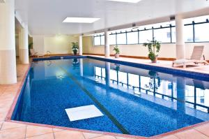The swimming pool at or near Oaks Sydney Castlereagh Suites